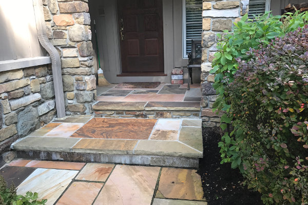 stone entryway by Frate Landscaping
